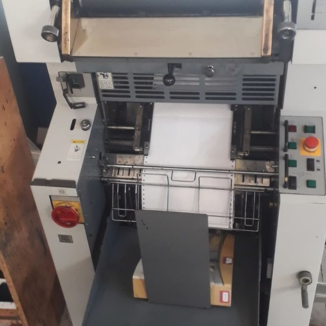 Used Ryobi Continuous Form Printing Machines and Polar paper cutter for sale.